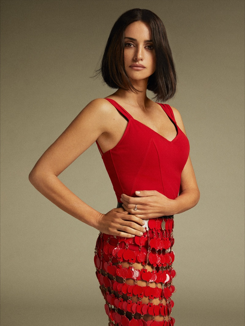 Dressed in red, Penelope Cruz wears Alaïa bodysuit and shorts with Lanvin skirt.