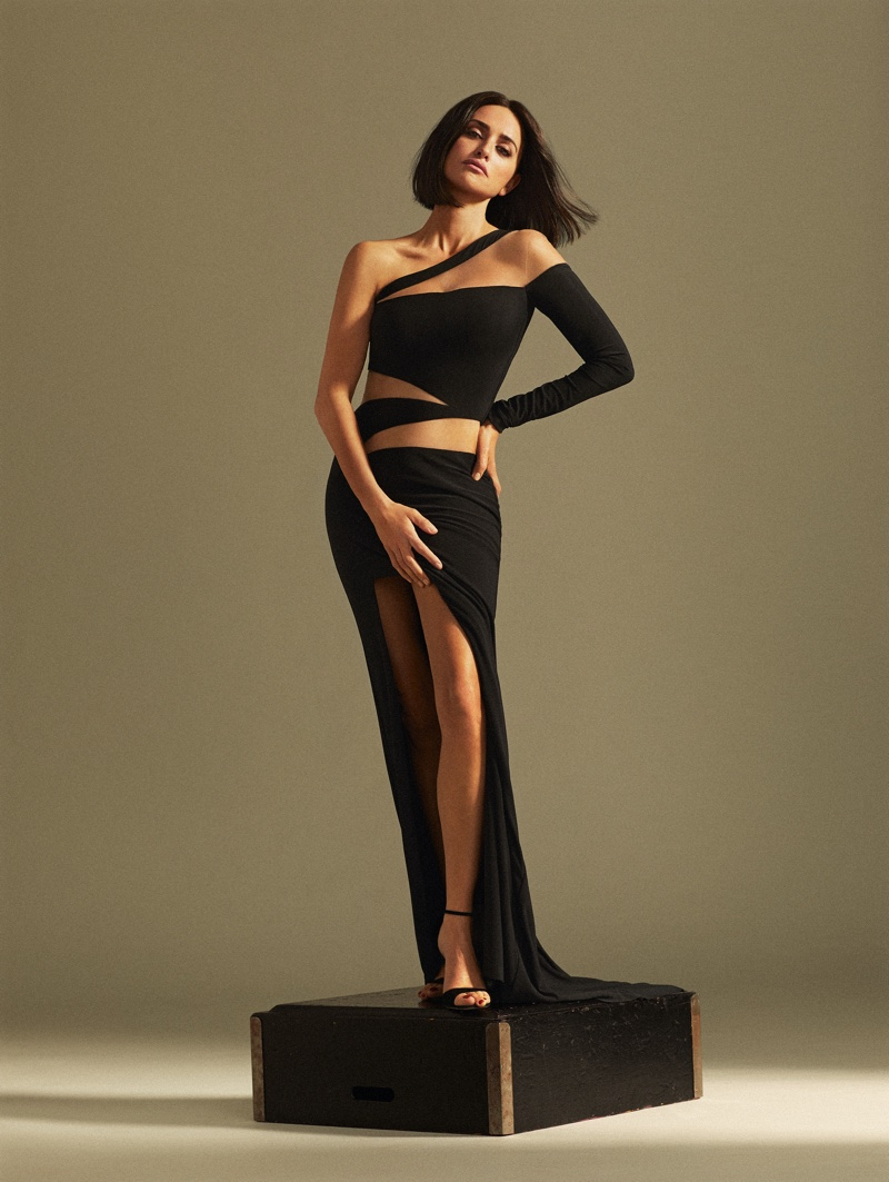 Striking a pose, Penelope Cruz wears Roberto Diz asymmetrical dress and Roger Vivier sandals.