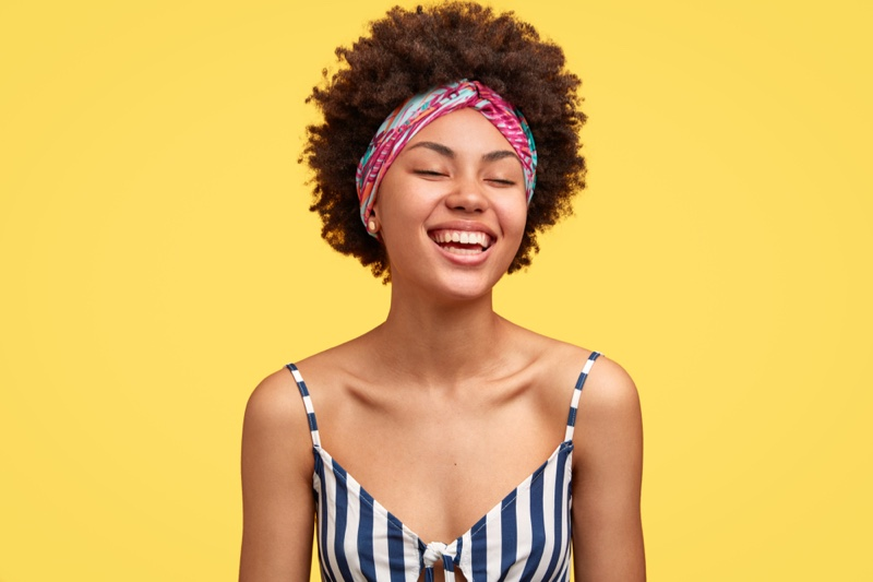 Smiling Model Headband Striped Top Afro Hairstyle