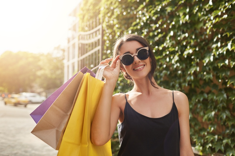 Smiling Model Shopping Bags Statement Sunglasses