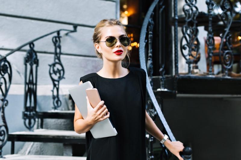 Stylish Woman Black Dress Sunglasses Holding Laptop Phone
