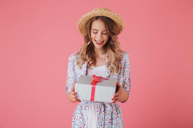 Stylish Woman Happy Holding Gift Box