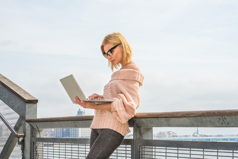 Stylish Woman Working Laptop Pink Sweater Jeans