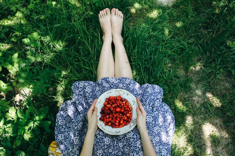 Woman Bowl of Strawberries Legs Grass