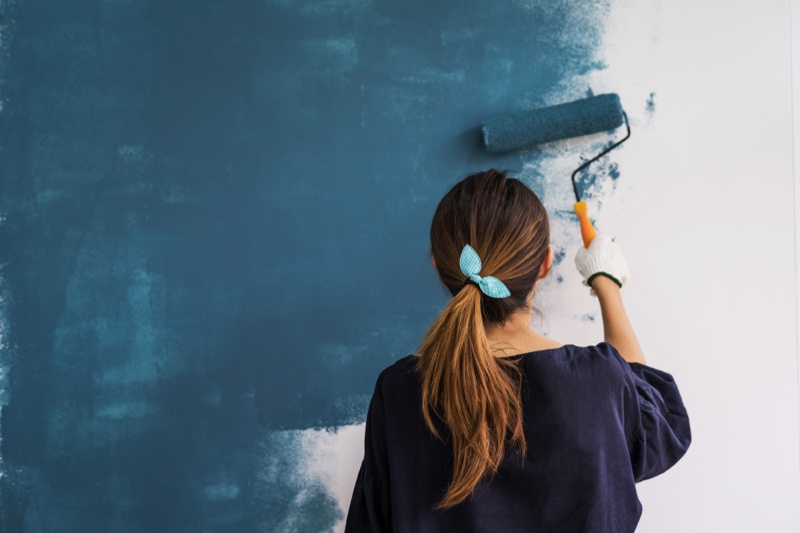 Woman Painting Wall Blue Back