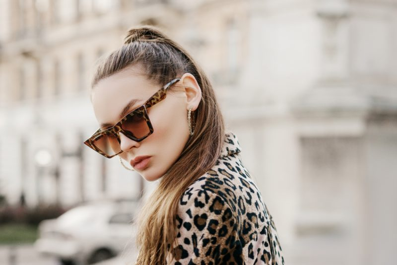 Woman in Leopard Print Sunglasses and Jacket