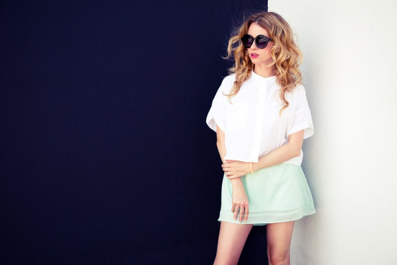 Woman in Skirt and Sunglasses