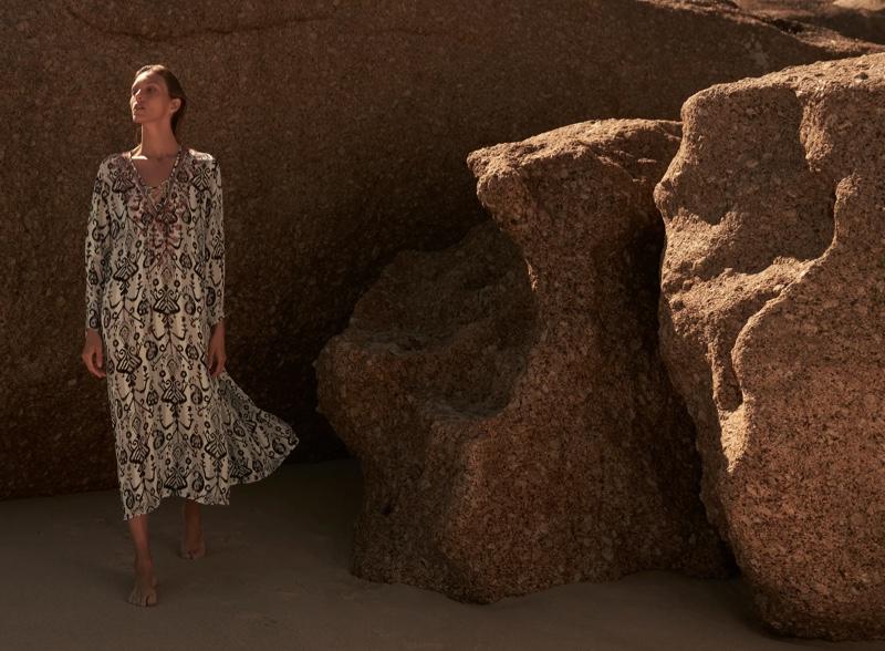 Anja Rubik poses in Zara embroidered midi dress.