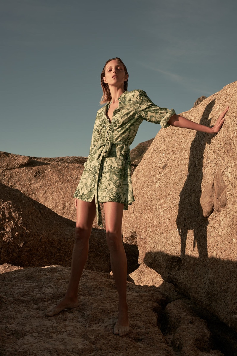 Posing at the beach, Anja Rubik wears Zara printed shirt dress.