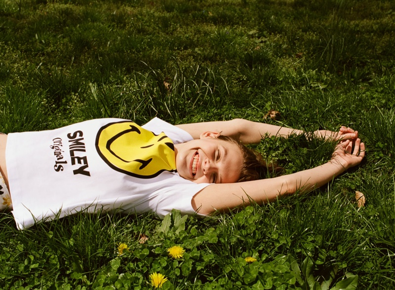 Looking happy, Cara Taylor poses in Zara  Smiley Happy Collection Shirt.