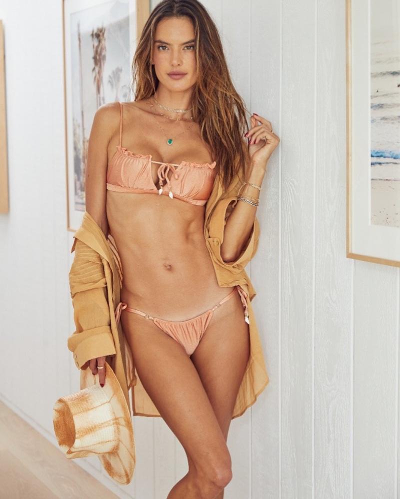 Alessandra Ambrosio poses in Gal Floripa Shell bikini set in Rosé.