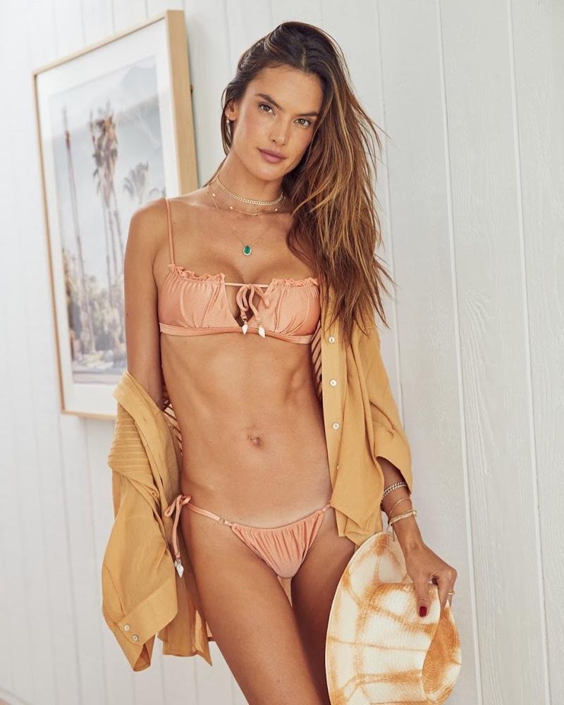 Flaunting her toned body, Alessandra Ambrosio wears Gal Floripa Shell bikini set in Rosé.