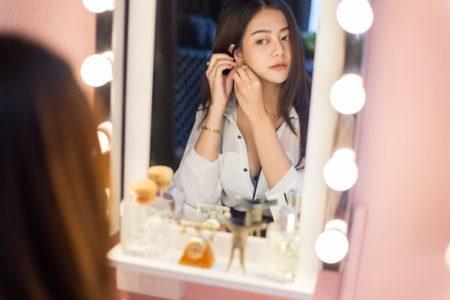 Asian Woman Looking Vanity Mirror