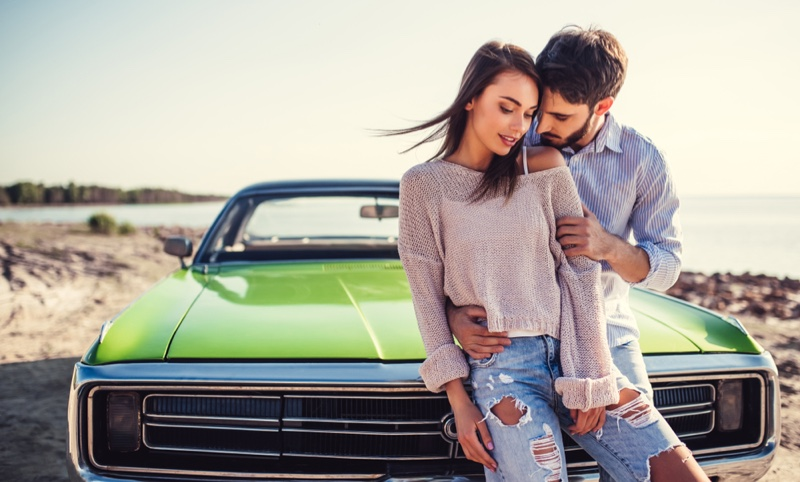 Attractive Couple Green Vintage Car Woman Ripped Jeans Sweater
