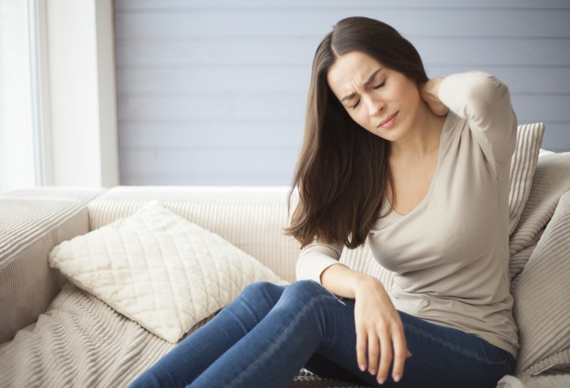 Attractive Woman Pained Couch back