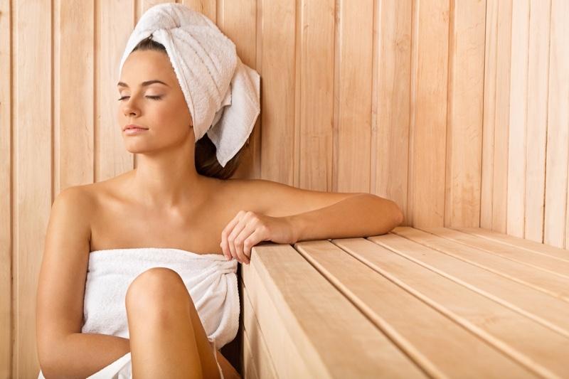 Attractive Woman Sauna Towel Covering Head Body