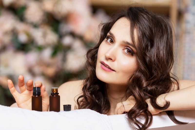 Attractive Woman Oil Bottles Beauty