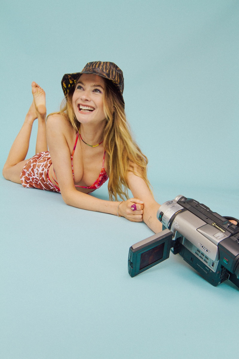 Posing with a camera, Behati Prinsloo fronts Behati x Reina Olga swimsuit campaign.