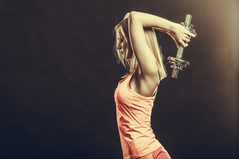 Blonde Model Lifting Holding Weight Exercise