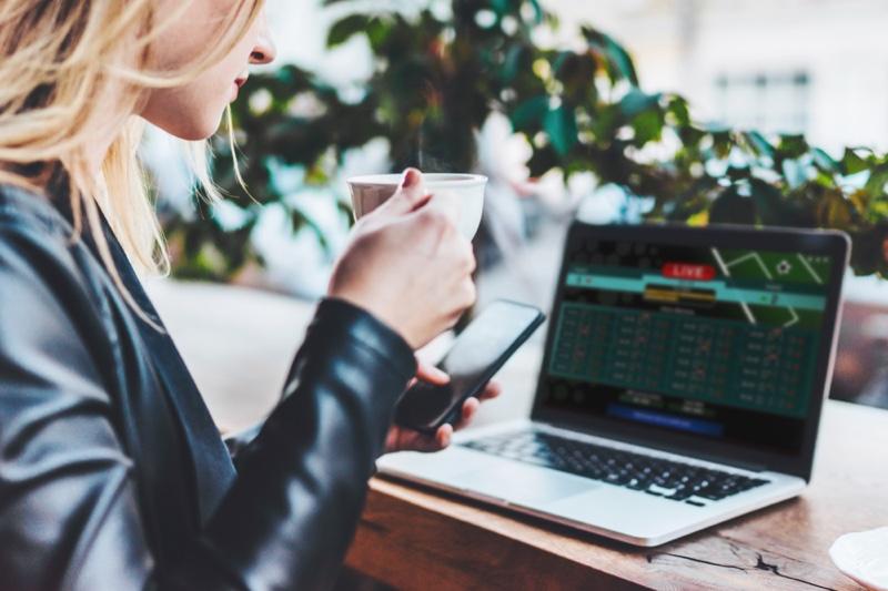 Blonde Woman Checking Poker Online Laptop