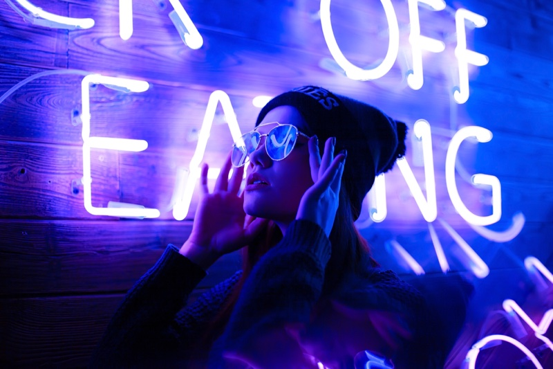 Gen Z Young Woman Posing Front Red Neon Lights