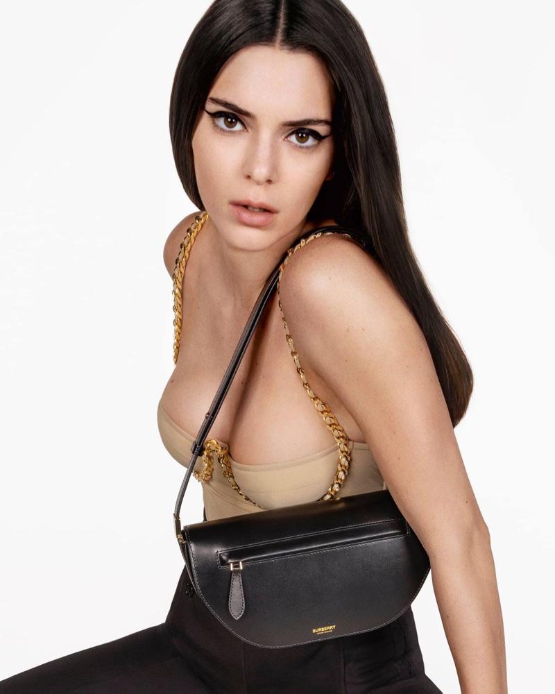 Kendall Jenner models alongside Burberry's Olympia bag.