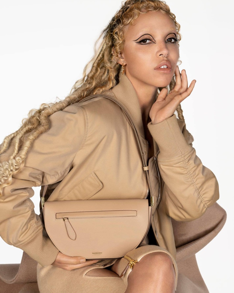 FKA Twigs poses for Burberry Olympia bag campaign.