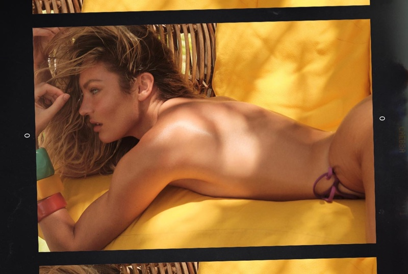 Candice Swanepoel wears Tropic of C Praia bottom in Violet.