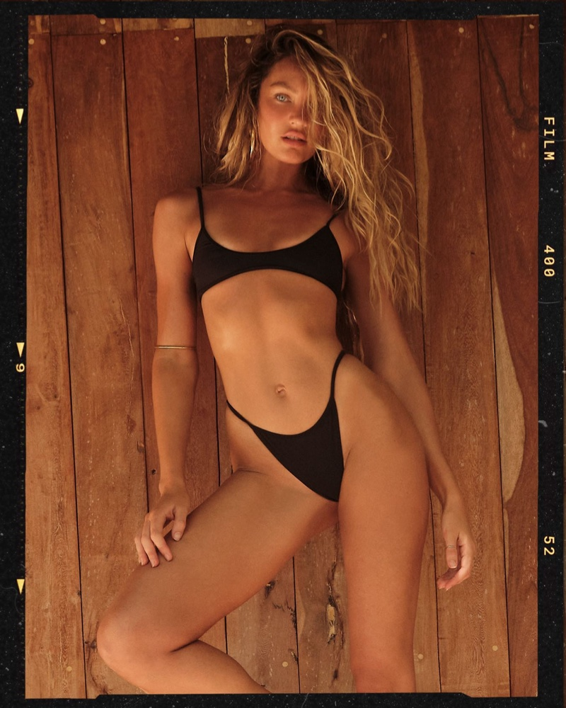 Clad in a black bikini, Candice Swanepoel fronts Tropic of C summer 2021 campaign.
