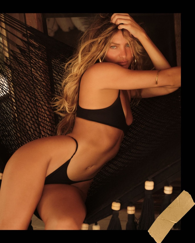 Candice Swanepoel models Tropic of C Rio top and Rio bottom in black.