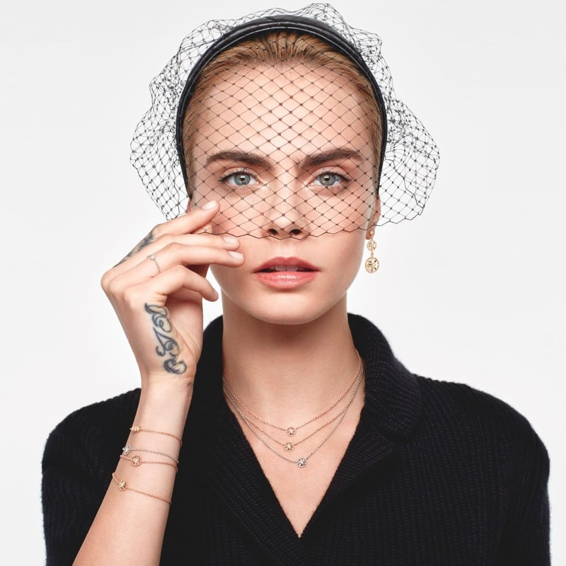 Wearing a veil, Cara Delevingne fronts Dior Rose Des Vents 2021 jewelry campaign.