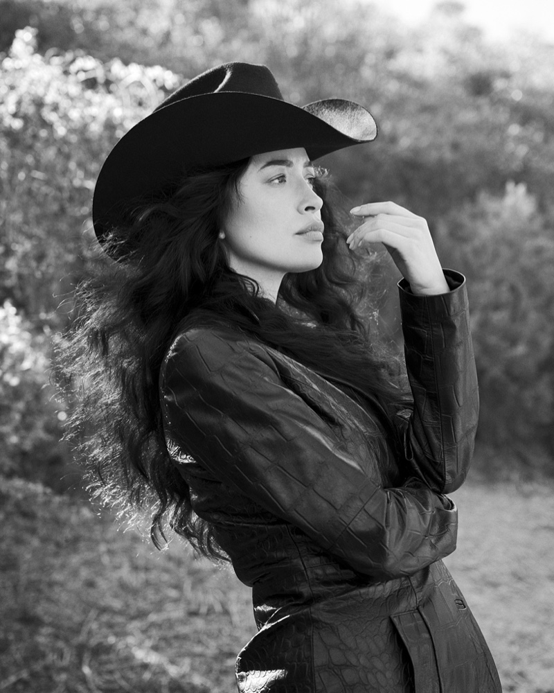 Photographed in black and white, Christian Serratos strikes a pose.