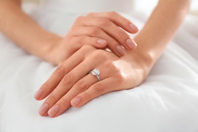 Closeup Woman's Hands Engagement Ring Diamond