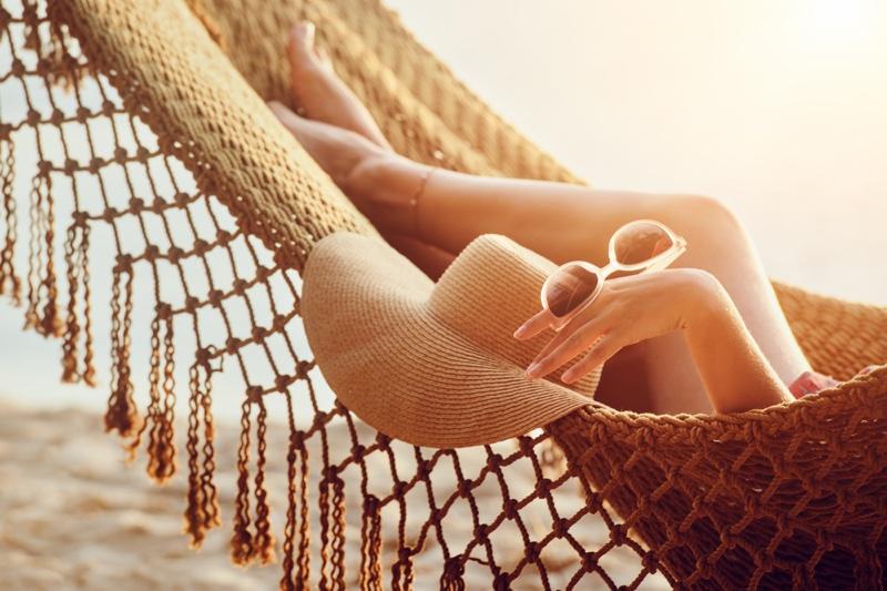 Cropped Image Model Hammock Beach Straw Hat Sunglasses Legs
