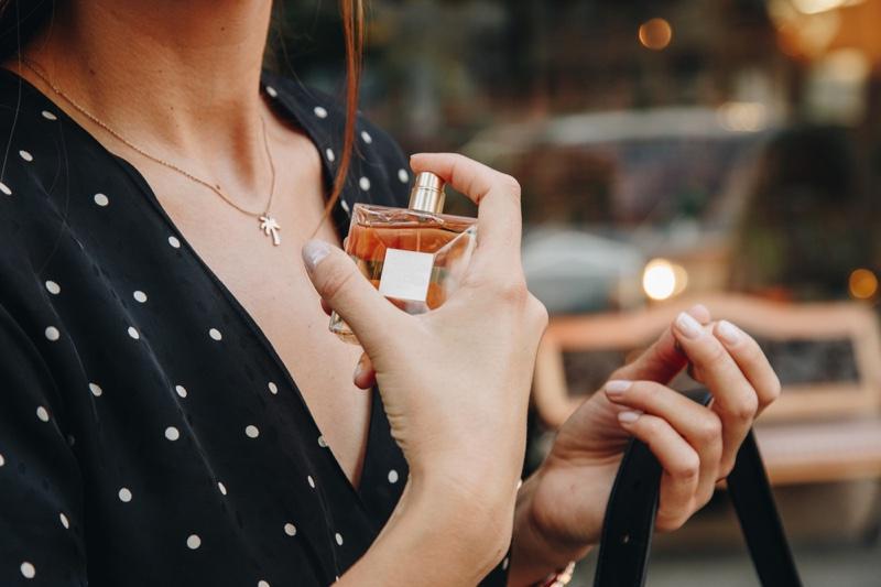 Cropped Model Holding Perfume Bottle Fragrance