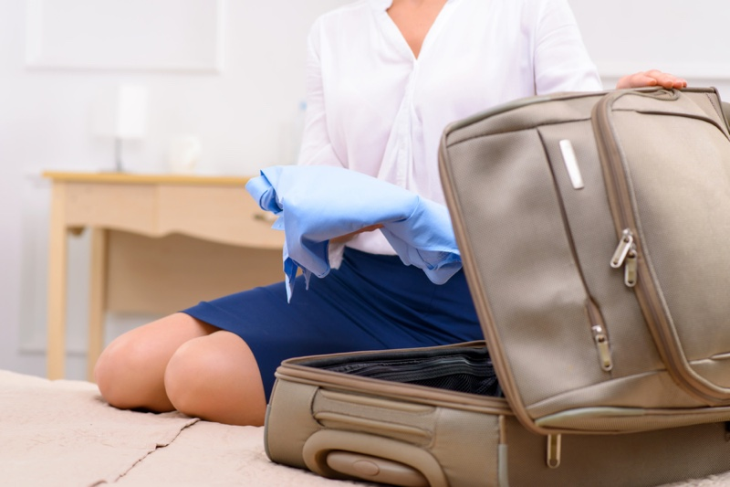 Cropped Woman Packing Suitcase