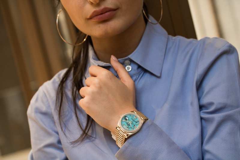 Cropped Woman Wearing Rolex Watch Gold
