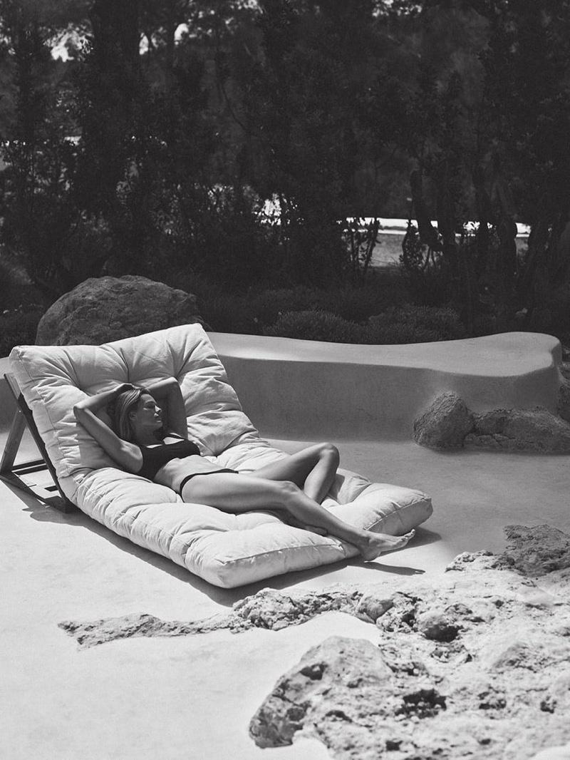Lounging outdoors, Edita Vilkeviciute poses for Zara Home.