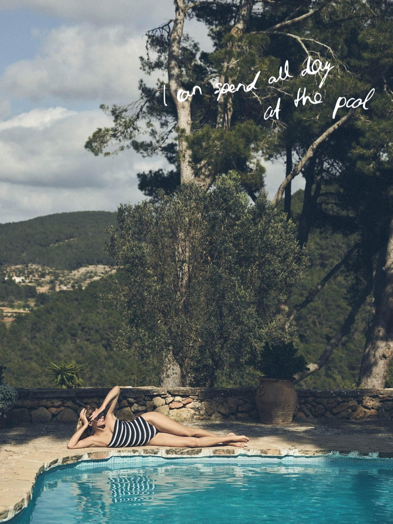 Posing poolside, Edita Vilkeviciute wears Zara Home striped swimsuit.