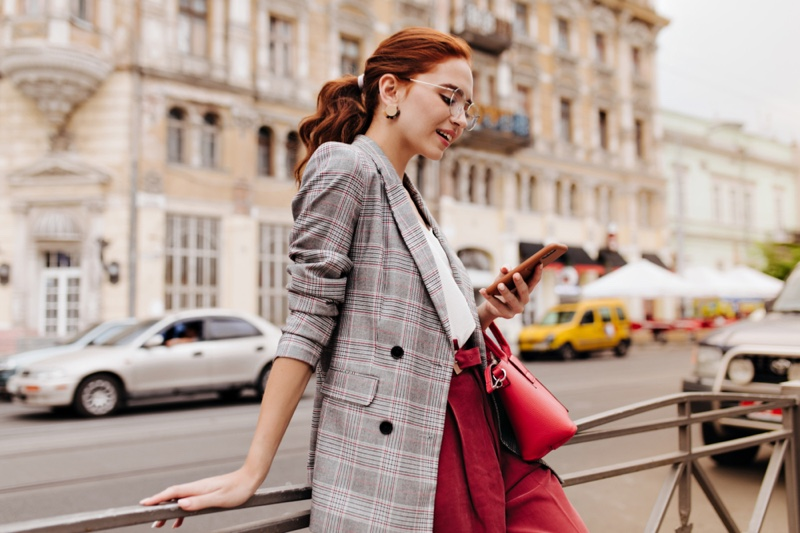 Fashionable Woman Checking Phone Street Plaid Blazer