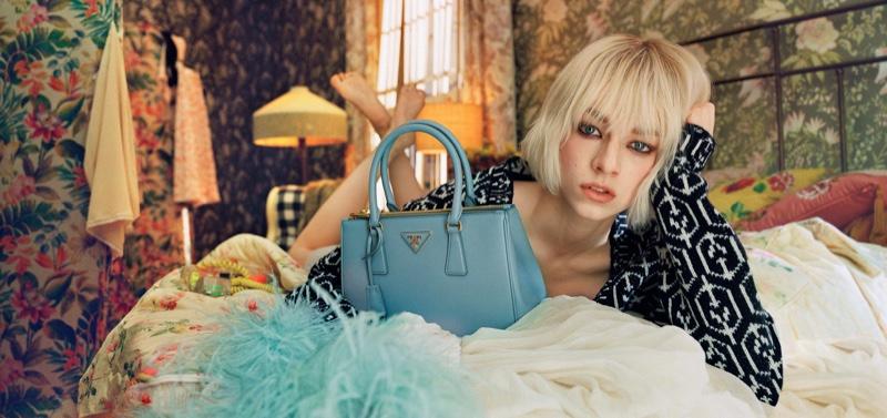 Actress Hunter Schafer appears in Prada Galleria handbag campaign.