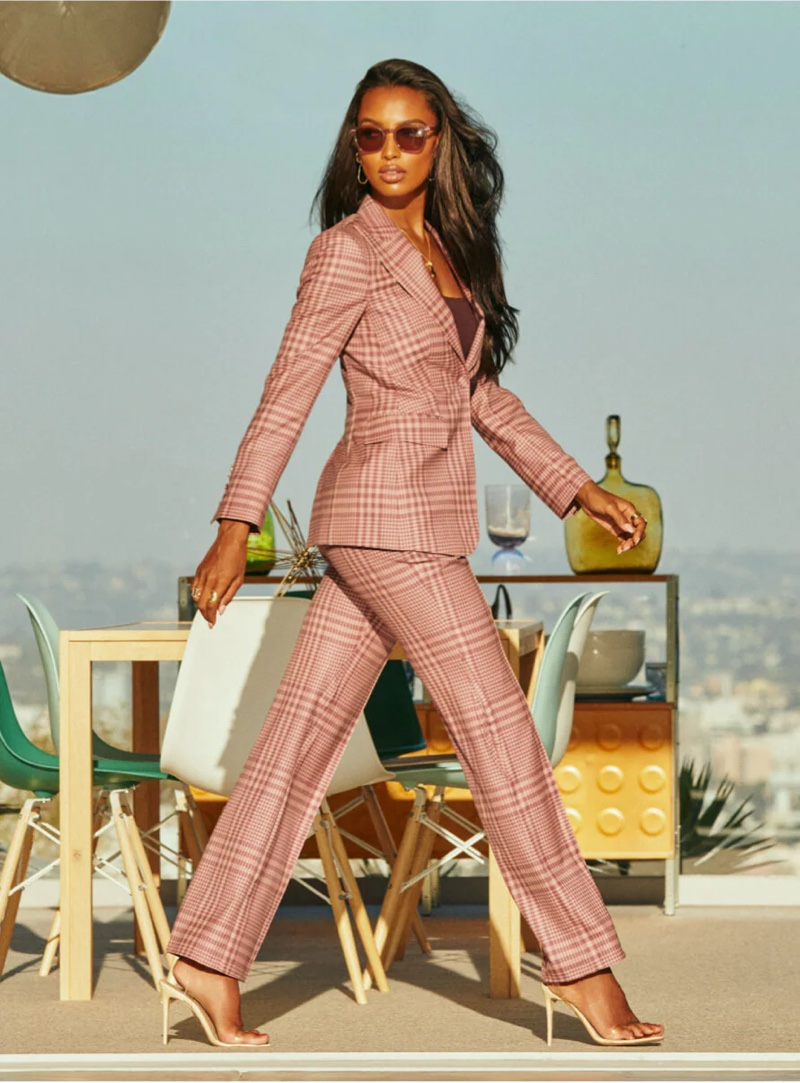 Suiting up, Jasmine Tookes poses for Oliver Peoples x Frére eyewear campaign.