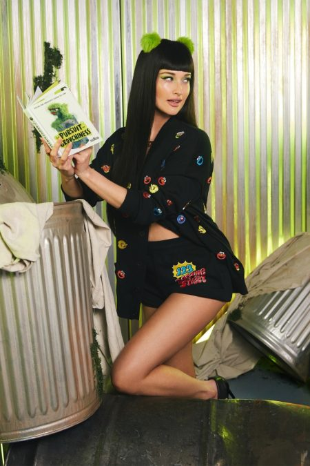 Kacey Musgraves channels Oscar the Grouch for Moschino x Sesame Street campaign.