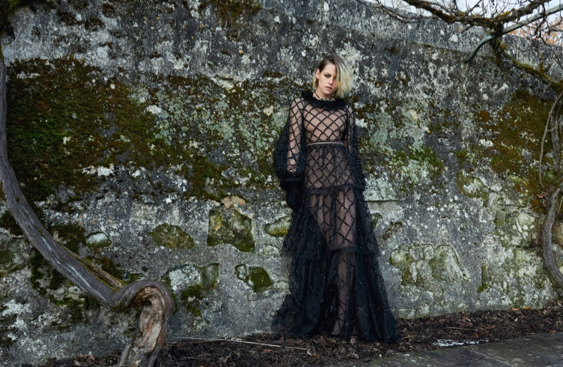 Kristen Stewart poses in a black gown for Chanel Métiers D'Art pre-fall 2021 campaign.