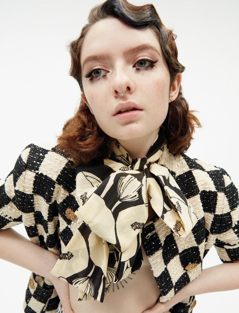Lachlan Watson wears checkered style.