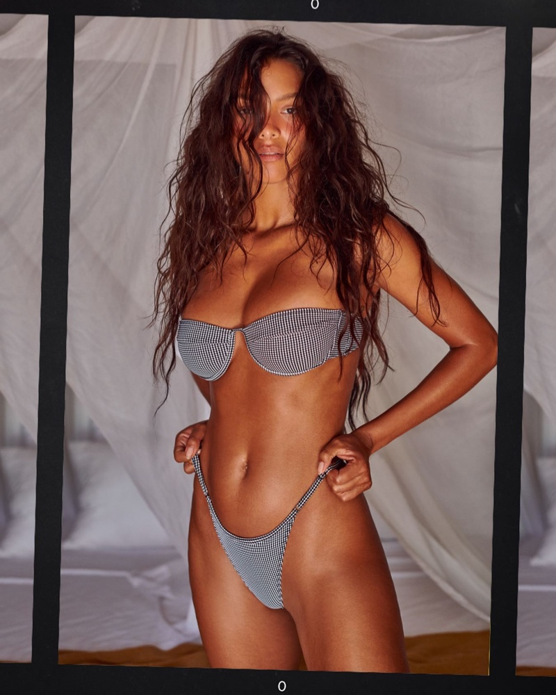 Model Lais Ribeiro poses in Tropic of C Mariel top and Luna bottom in black check.