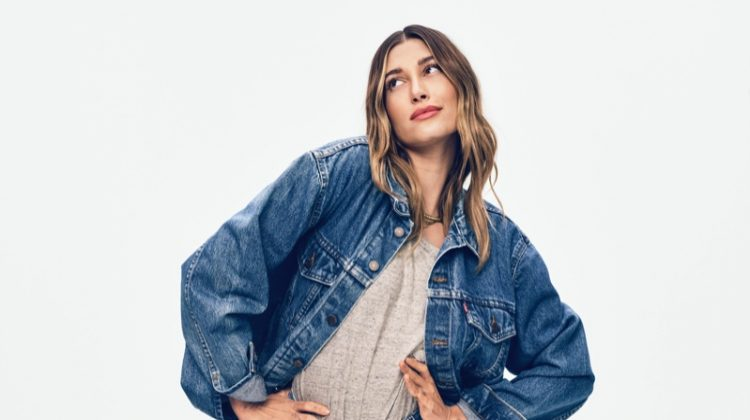 Model Hailey Bieber poses in denim for Levi's 501 Originals campaign.