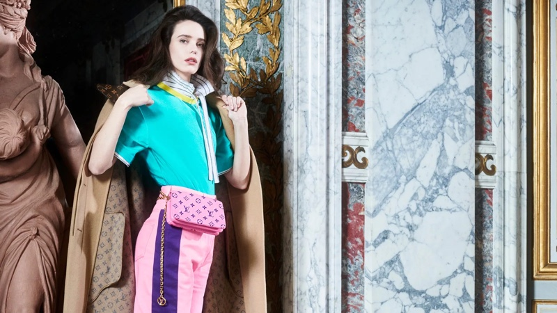Stacy Martin poses with Pochette Coussin bag in Louis Vuitton pre-fall 2021 campaign.