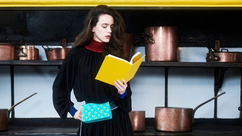 Reading a book, Stacy Martin fronts Louis Vuitton pre-fall 2021 campaign.