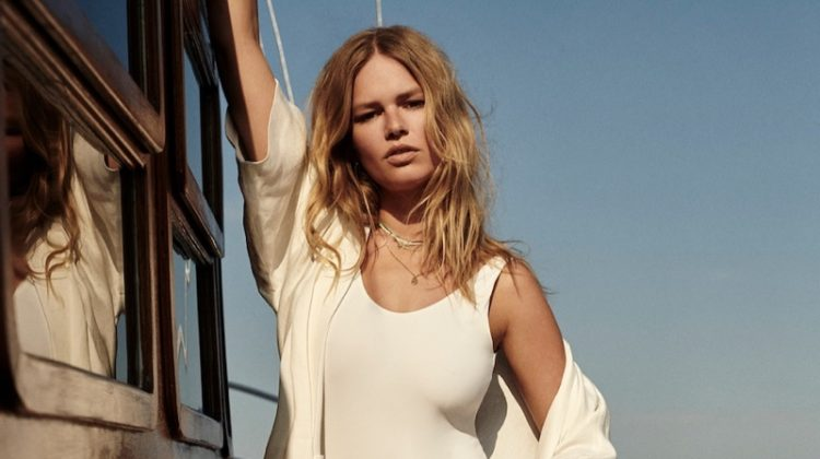 Model Anna Ewers poses in Massimo Dutti linen kimono and swimsuit with low-cut back.